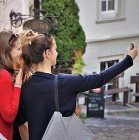 Tourists taking selfies