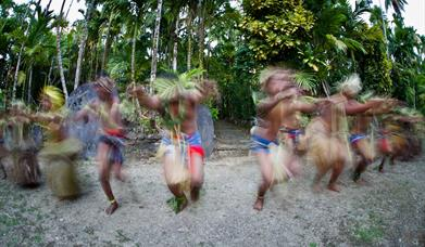 Traditional dancers on South Pacific Island participating in cultural tourism
