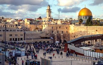 Tourists at the Western Wall and Dome of the Rock in Jerusalem