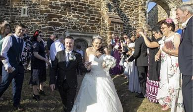 married couple leaving the church