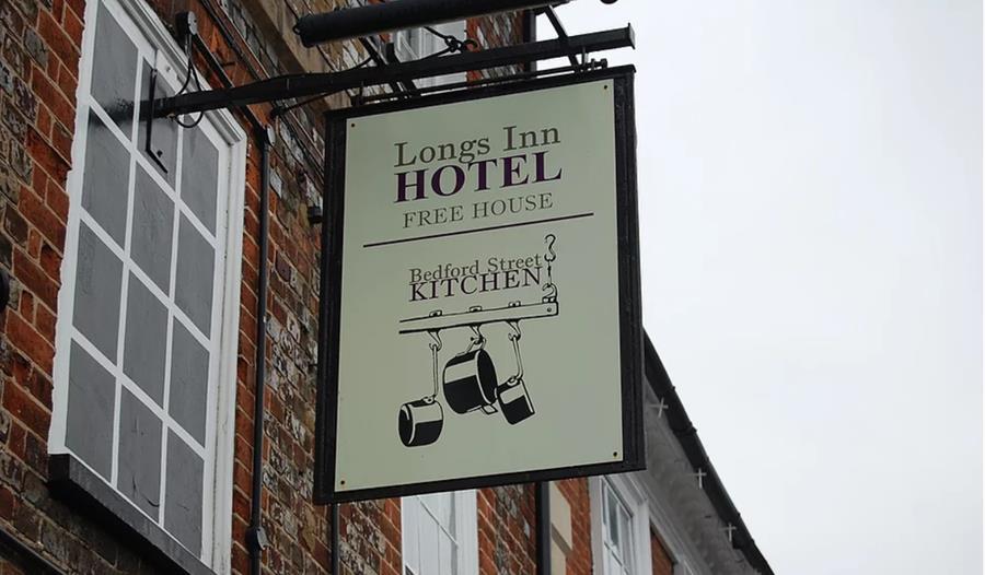 b&b sign outside the longs inn hotel