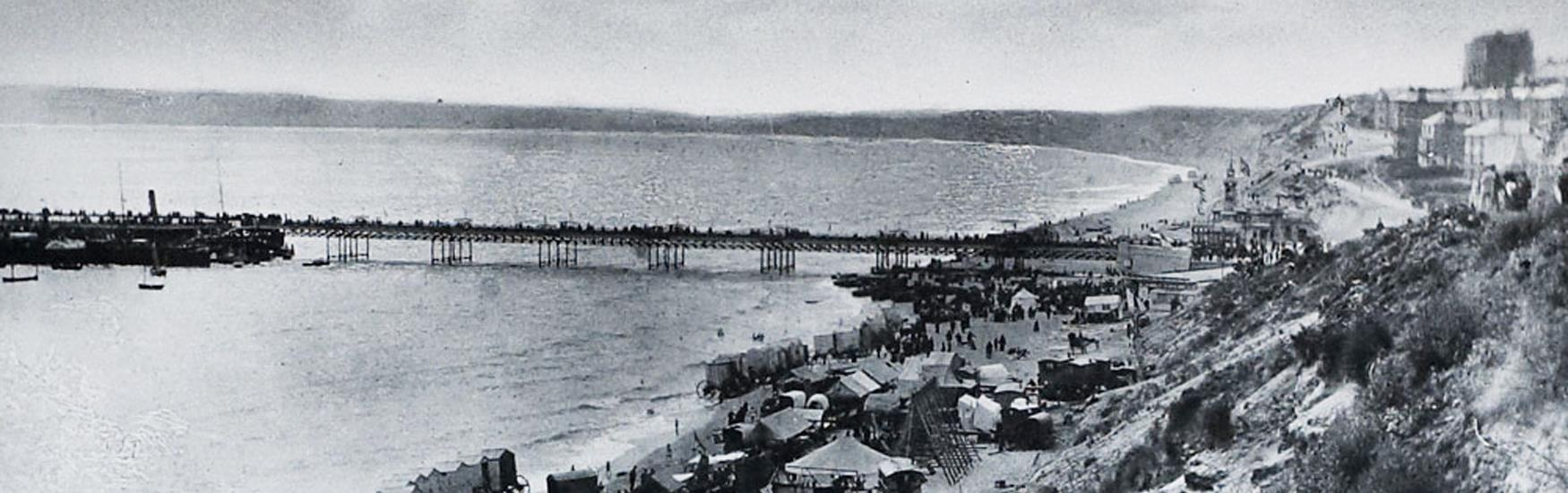 Bournemouth East Beach year 1890. Amusement Fair, bathing huts and horses on the beach
