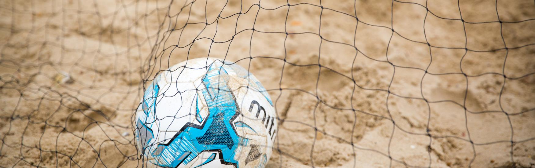 Football in net on Bournemouth Beach