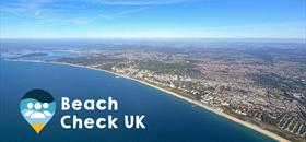 Arial shot of the south coast line with Beach Check UK logo overlaid on top