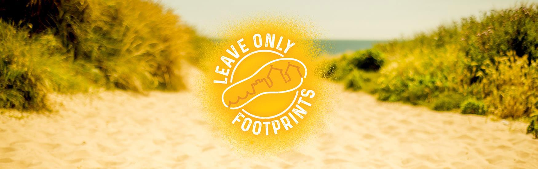 Sunny beach background with Leave only footprints logo in front