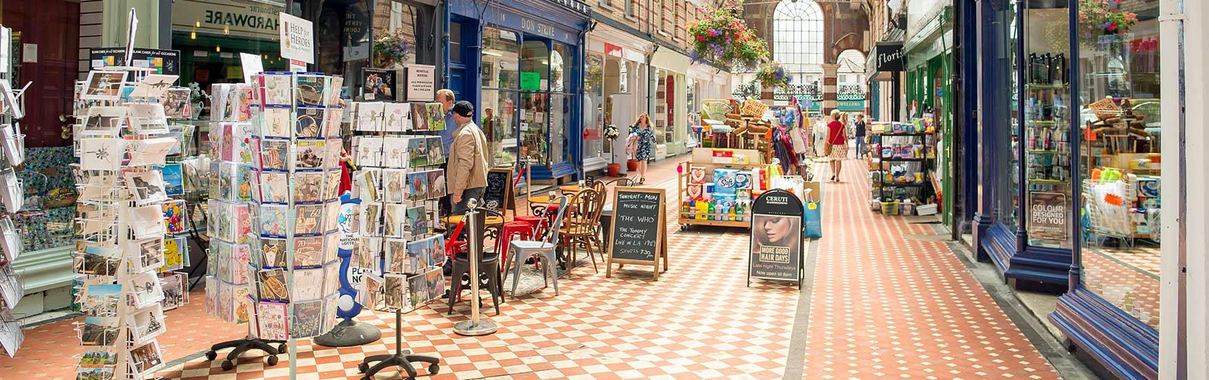 Westbourne shopping arcade showcasing goods and shops for keen Bournemouth shoppers