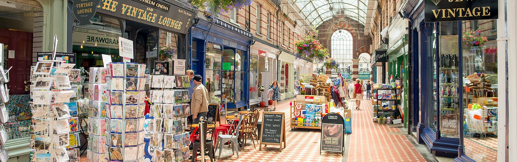 Westbourne arcade filled with customers enjoying a browse of the local products and cafes
