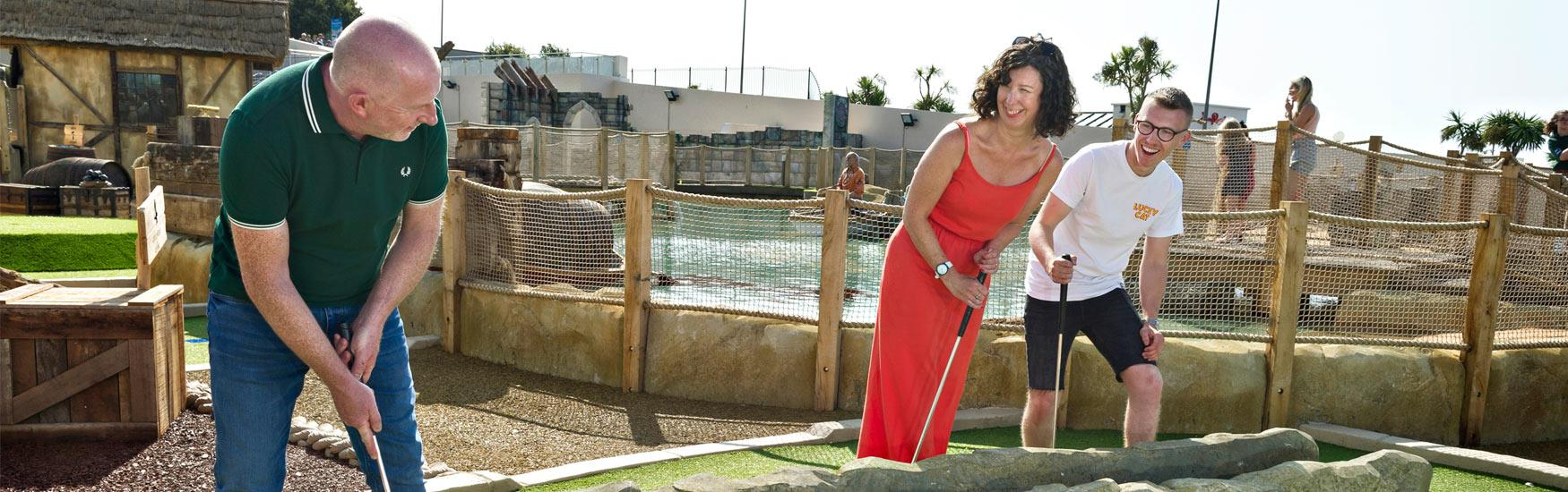 Group playing golf at Smugglers Cove Adventure Golf