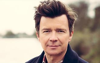 Recent photo of Rick Astley outdoors.