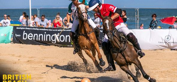 Polo players on Sandbanks Beach during a match