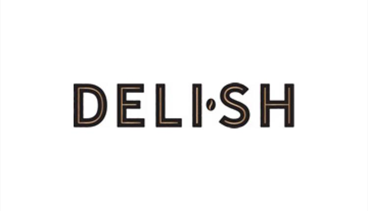 The words Deli-sh seperated by a point, black on white.