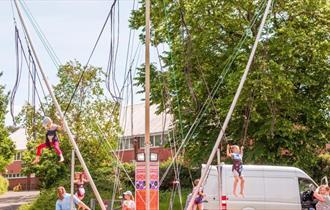 children enjoying a bungee activity.