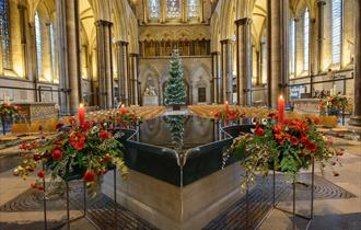Interior grand cathedral with Christmas themed flower display