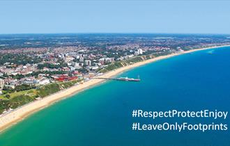 Bournemouth beach with message overlay: #RespectProtectEnjoy #LeaveOnlyFootprints