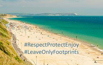 Southbourne beach with message overlay: #RespectProtectEnjoy #LeaveOnlyFootprints