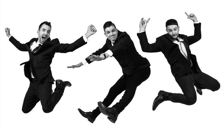 Three man in black and white jumping in the air