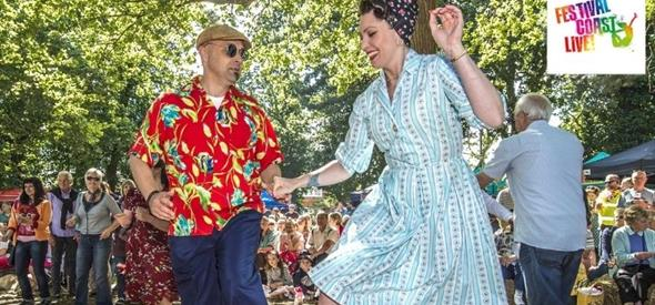 Man in coloured shirt dancing with a lady underneath the trees