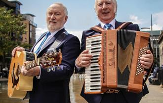 Foster and Allen with their instruments