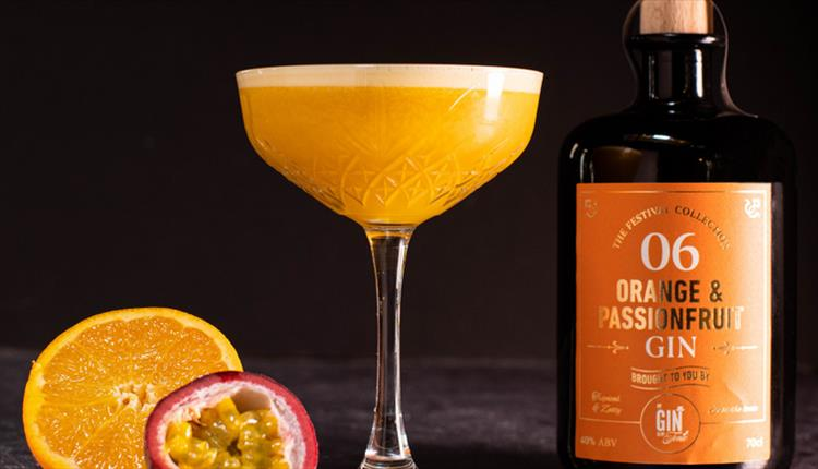 Gin festival promo images featuring bottle and glass of Orange & Passionfruit Gin