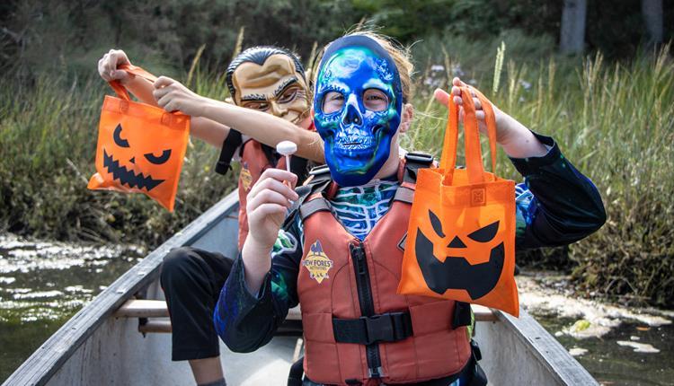 Children enjoying a Halloween Candy Canoe Hunt