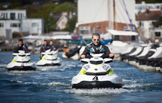 A group of people using the Jetskis from the Jetski Safari group