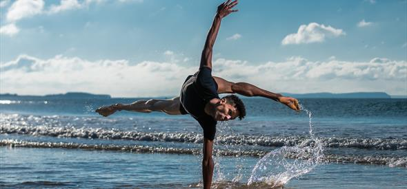 dancer performs in the sea