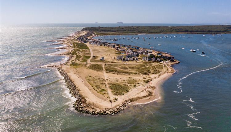 beaches, aerial, birds eye view, shot from above, land, beach, blue sea, blue water, blue sky, boats, beach huts