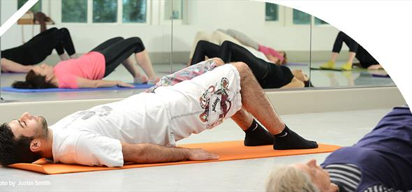 Group of people on yoga mats