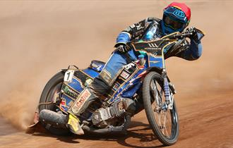 One of the Poole pirates skidding round the corner on the dirt track during a race