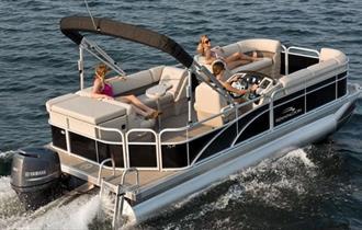 Three people sitting on a boat enjoying the views