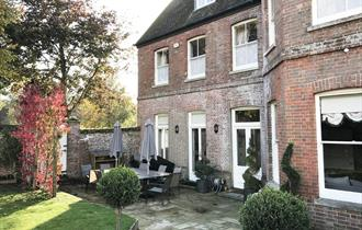 Outside garden with table and chairs and beautiful large house