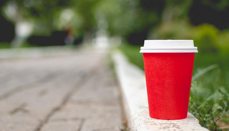 Red coffee cup on wall