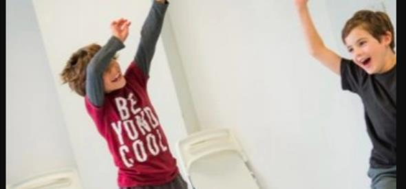 Two boys having fun in a dance class