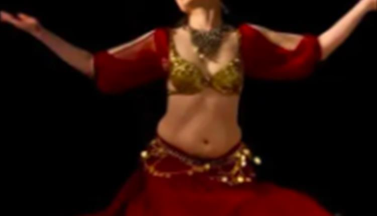 Woman dressed in red and gold dress on stage