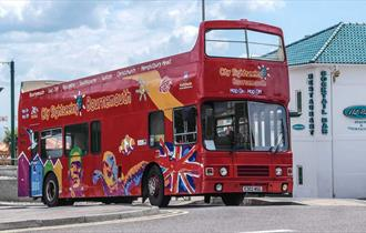 Bournemouth's open top sightseeing bus parked near the beach