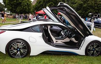 White electric car with door open