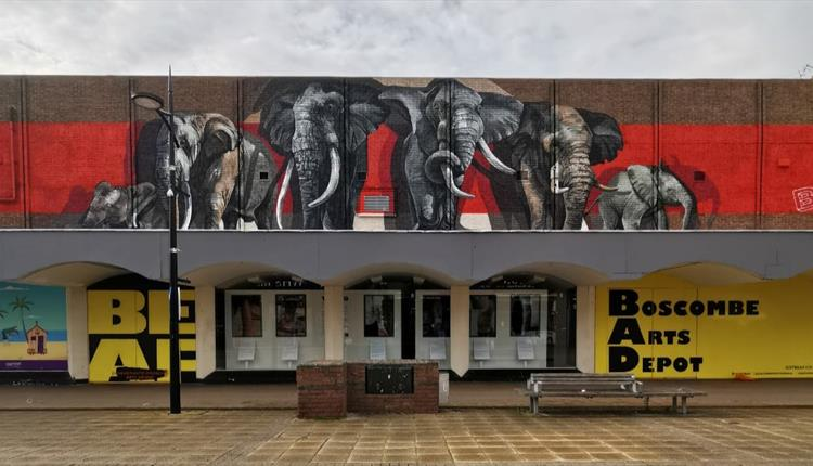 A row of colourful painted elephants