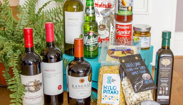 A collection of Greek food, wine and condiments