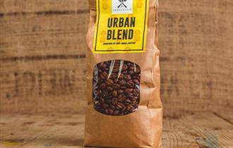 Whole coffee beans in a beautiful bag