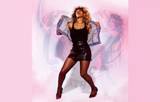 What's Love Go To Do With It, tina turner dancing, woman dancing in leather black skirt with pink background