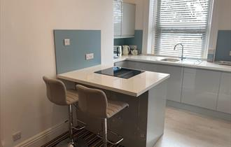 Modern fresh interior kitchen with duck egg and light grey finish