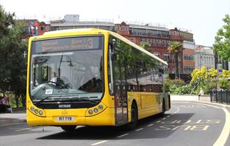 Yellow bus through centre of Bournemouth
