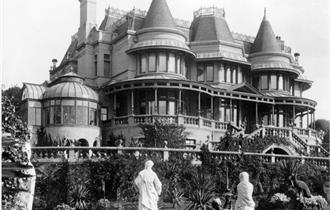 Black and white photograph of the museum with garden statues