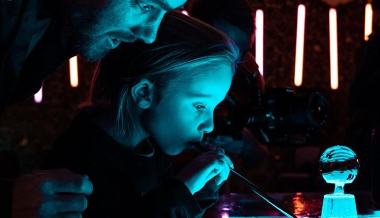 Father and daughter enjoying bubble workshop