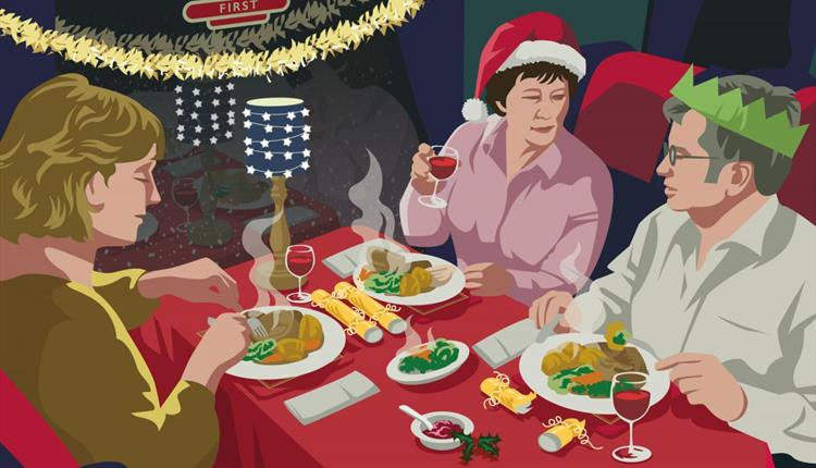 Family sitting around a table with food and Christmas decorations
