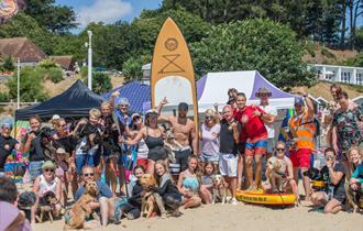 Group photo of shaka surf crew on the beach