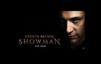 derren brown lloking at camera with dark background and his name in text to the left