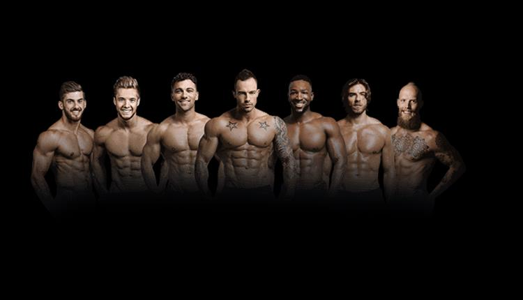 Forbidden Nights group of male dancers, posing and smiling to camera, black background