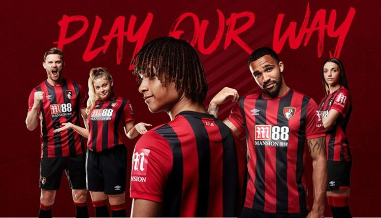 Players model the AFCB home kit with the slogan 'play our way'