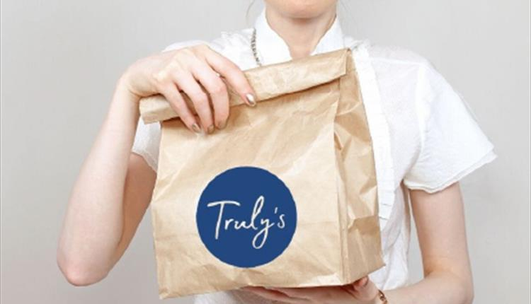 Truly's service in a paper bag